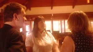 Stop the Ban coalition members Aram James and Edie Keating discuss issues with judicial candidate Annrae Angel (in center)