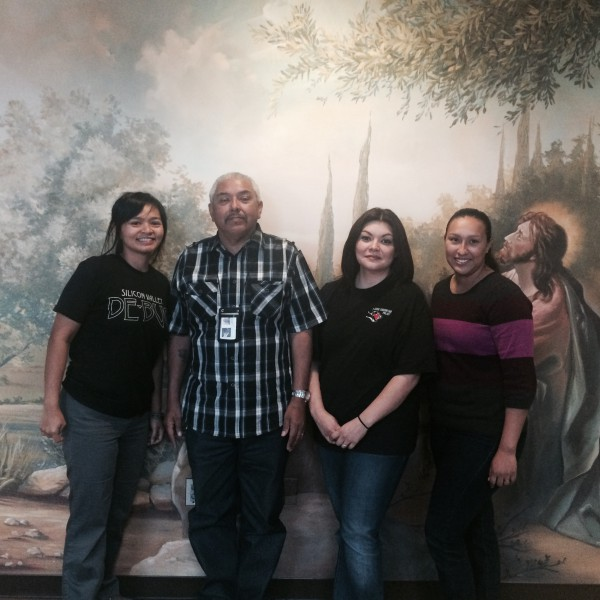 Daniel and Carla (middle) are the first points of contact of individuals who are first released from prison, and provide a wide array of services, mentorship, support, community, and prayer for formerly incarcerated individuals transitioning into the community.  Charisse and Cecy met with Daniel and Carla to support their families who may have contact with the system to learn how to advocate effectively for their loved ones.  This photo was taken in the Reentry Center's Prayer Room.