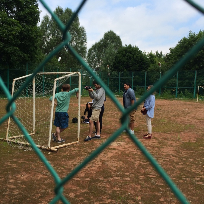 Some participants shooting a scene for the social bio video. In this scene, they had to pick a location that emphasized the role of the child -- so they went to a soccer field.