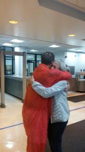 Rusty and his mom hugging as he leaves jail, a free man after having served four years of what would have been 3 life sentence.