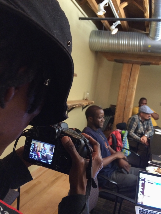 Taye, an artist and organizer with Spirit House, photographs the first participatory defense meeting in Durham!